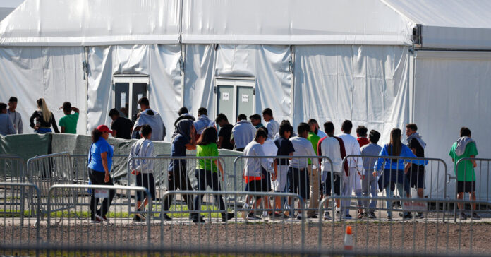 A court filing says 445 migrant children are still in custody after being separated from their parents under Trump.