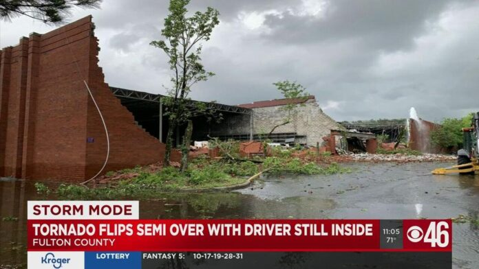 Truck driver recalls the moment winds flipped his big rig over during severe storms