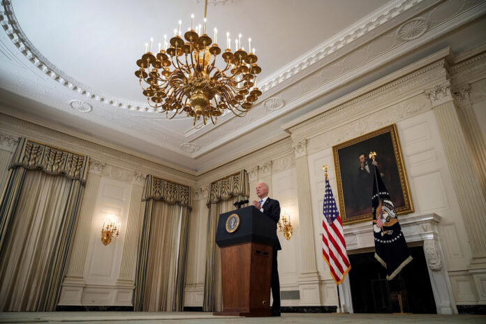 President Biden speaks about the nation's economic recovery on Monday in the State Dining Room of the White House.